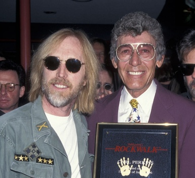 Musicians Tom Petty and Carl Perkins attending 'Carl Perkins Receives Hollywood Walk of Fame Star' on June 11, 1996 at the Hollywood Walk of Fame in Hollywood, California. (Photo by Ron Galella, Ltd./Ron Galella Collection via Getty Images